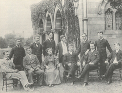 Agatha Tiegal Hanson is the sole woman of the class of 1893. She sits among the men in this picture, which is taken outside of Chapel Hall