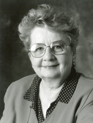 Gertrude Scott Galloway in a black and white photo. She's wearing a black polka dot blouse under a solid colored jacket. She has glasses -- appears to be in her 50s or 60s.