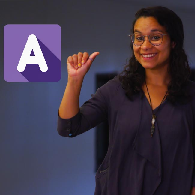 "Puerto Rican  woman signs ""A"" with purple block and white letter of A icon."