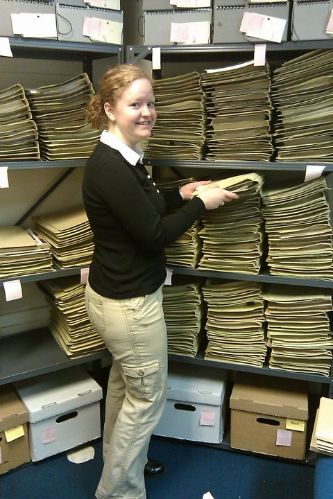 Graduate student assistant Kati Morton at work helping to sort and organize the collection.