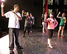 Image: Students practice on stage