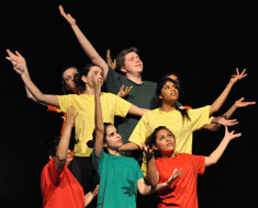 Image: MSSD student Wendy Brehm (wearing turquoise shirt) performs in 'The Seeds,' part of the QuestFest Community Showcase. (Photo: Goodman/VanRiper)
