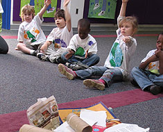 Image: Students in a classroom with recycling items on floor