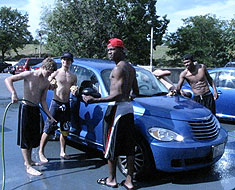 Image: Members of the MSSD football team staged a car wash on September 11, 2010 to raise money for the team travel fund. Over $500 was raised. (Photo: Susan Flanigan)
