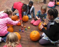 Image: KDES students working on pumpkins