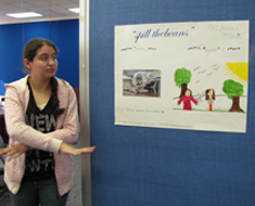 "Image: Johanna Cruz illustrates in ASL the English idiom, ""spilled the beans."""