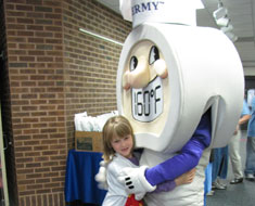 Image: KDES student Faith Hutson shares a hug with Thermy
