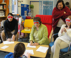 Image: During a training session, Clerc Center teachers and staff wear eye masks to simulate loss of sight.