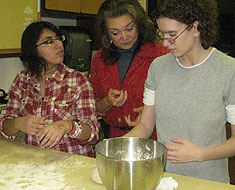 Image: As a follow up activity to her discussion on Lumbee I ndian heritage, Judy Stout gave a demonstration to students on how to make I ndian Fry Bread. Pictured here Stout (center) starts MSSD student Dulce Avina-Ochoa and Tifanny Van Boxlaere on