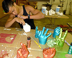 Image: MSSD Davante Kirk works on one of the handshape sculptures.