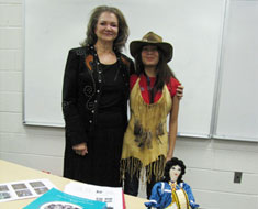 Image: The MSSD Diversity Club invited M SSD student enhancement educator Judy Stout (left) to give a talk on November 17 about her Lumbee Indian heritage. After the presentation MSSD student Hazel Fajardo tried on Stout's Lumbee-designed leather hat and deerskin vest with feathers.