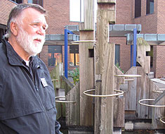 Image: Chuck Baird stands by the golden rings art installation he created for the MSSD fountain.