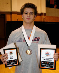 Image: Albert Blake finished with a First Place medal along with Most Pins and Most Outstanding Wrestler awards. (Photo: Jolynn Ferguson)