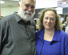Image: Clerc Center interpreter Juniper Sussman poses with Chuck Baird, her uncle, at the reception held in the MSSD Star Gallery.