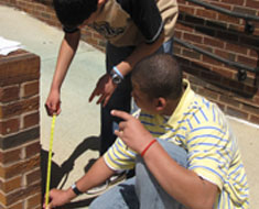 Image: KDES students measure slope rise on ramp. (Photo: Susan Flanigan)