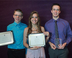 "Image: Ernest ""Chad"" Willman (far right) poses with the Award for Excellence in the Arts that he received at the Kennedy Center on May 15. Pictured with Willman are MSSD Certificate of Merit winners Brennan Terhune-Cotter (left) and Kaori Vazquez.  (MSSD Certificate of Merit winner Chelsea Korn not pictured)"