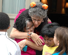 Image: First Lady Vicki Hurwitz gives a welcoming hug
