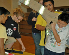 Image: KDES students team up for The Great Race--trying their best to don as fast as possible a fire-fighter's outfit weighing 60 lbs. Students enjoyed a variety of fire safety activities on October 14.