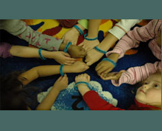 "Image: KDES Kindergarteners display ""I am Somebody"" bracelets which they received after a read-aloud of the  Berenstain Bears story, ""Bullying."" (Photo: Susan Flanigan)"