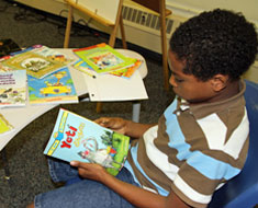 Image: At the May 31 book distribution, Amo Konkel-Harmon browses available books. (Photo: Susan Flanigan)