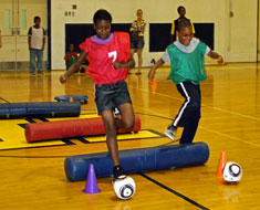 Image: LaDasha Williams and Noah Richards compete in one of the ESY Olympic events. (Photo: Susan Flanigan)