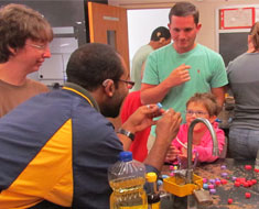 Image: MSSD alumnus Joseph Mosely (front left) during his JMU internship visited with deaf and hard of hearing students at a local school to spark their interest in science. The activity was designed to teach students about proteins. (Photo: Courtesy of JMU)