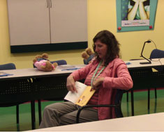 Image: A trainer models to parents how to read a story in ASL.