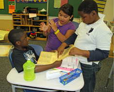Image: Fourth graders review a facsimile of the Constitution.