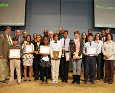 Image: The winners of the poster, multimedia, and essay contest held as part of Gallaudet University's DC Emancipation Day Sesquicentennial Celebration gather together with Gallaudet University officials and author Tim Wise (back row, third from left).