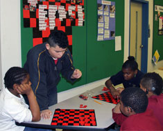 Image: Students applied their literacy, math, and science skills in demonstrating how to play popular games, such as chess. (Photos: Susan Flanigan)