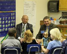 Image: Rosenblum and Wagner stopped in to visit with KDES first and second graders during their American Sign Language class.