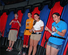 Image: The crew onboard a G-force accelerator prepares to experience three times the force of push against centripetal force. Right to left: Claudia Giordano, Emily Schreiner, Kyle Lauderbaugh, and Dalton Arnes.