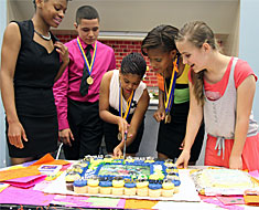 Image: KDES 2013 honorees: Anisha Calhoun, Jason Cruz, Azahri Rilley, Chanice Coles, and Elizaveta Shanuarina cut their celebration cake following the Honorees Recognition Day ceremony held on June 5.