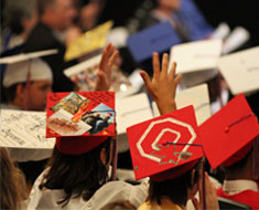 Image: A long-standing tradition continues, the decorating of graduation caps and gowns.