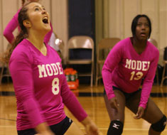 Image: The MSSD volleyball teams tested out their new pink uniforms to honor the campaign for Breast Cancer Awareness Month.