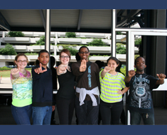 Image: MSSD students (from left) Mary Ann Gardner, Juwan Blackwell, Kelly Doleac, Emmanuel Njoku, Johanna Cruz, and Mikail Baptiste spell out A-L-A-B-A-M-A, the location of the 2012 Deaf Space Camp at the U.S. Space & Rocket Center. The MSSD students joined students from other schools for the deaf and were assigned to either the Jolly Goddard or the Van Lions for team activities throughout the week. (All photos: Mark Tao)