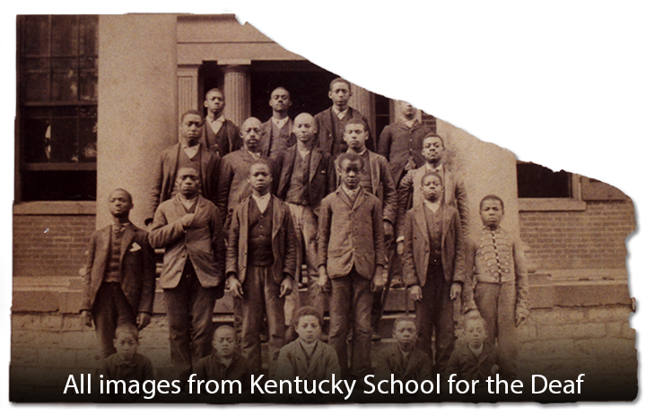 African American male students standing in front of the Kentucky School for the Deaf.