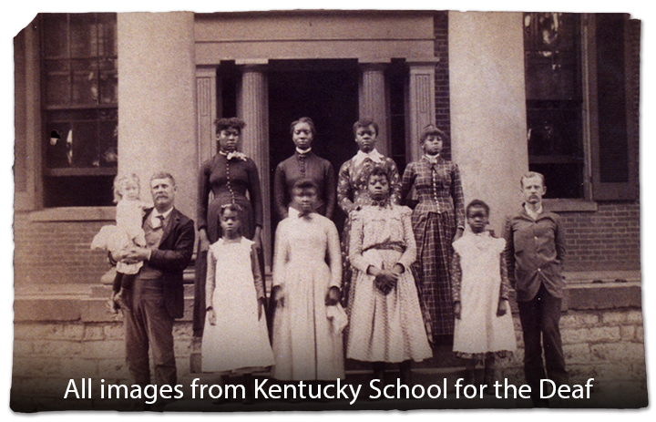 African American female Deaf students standing in front of the Kentucky School for the Deaf.
