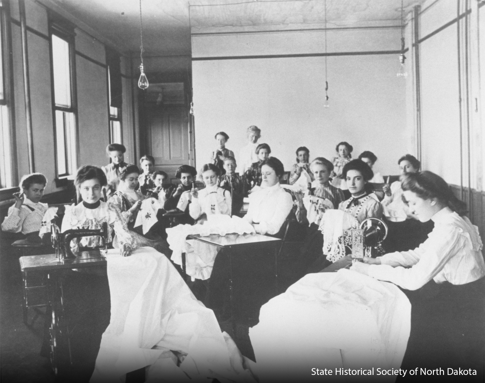 Students in sewing class at the North Dakota School for the Deaf.