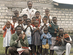 Foster posing with students, in Goma