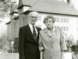 David Peikoff and his wife Pauline standing outside the Alumni House which now bears their name.