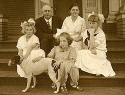Family photo with Olof Hanson and Agatha, with their children, all dressed up.