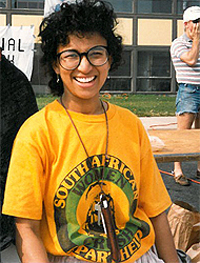 Wilma Newhoudt-Druchen, with an anti-apartheid t-shirt, working a social work booth at homecoming