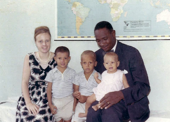 Andrew Foster with wife Berta and their three children. Colored photograph.