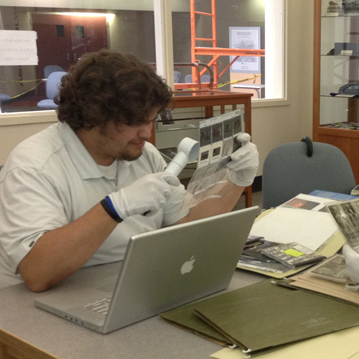 Museum staff work on photo archives