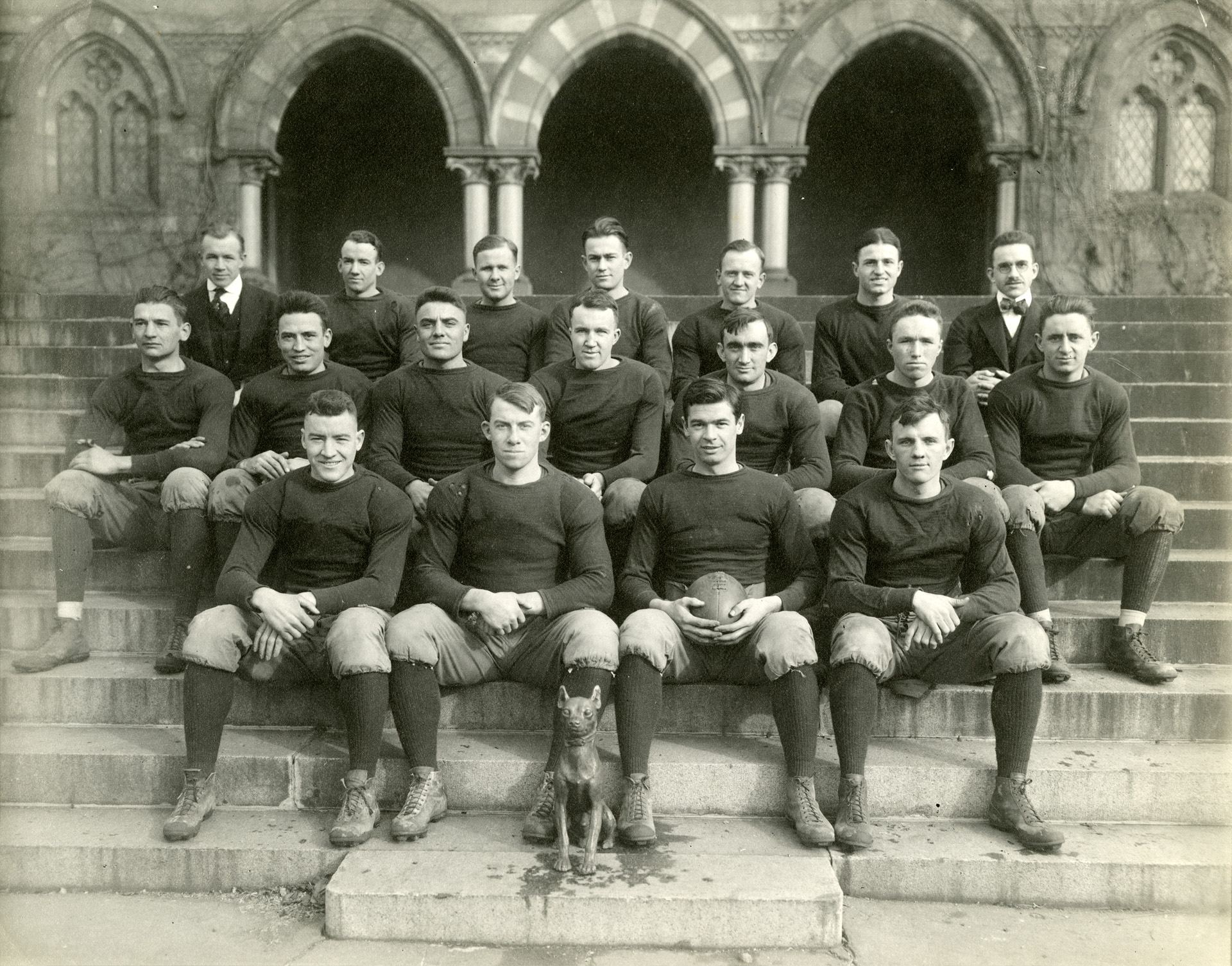 Blk/white photo of Football players in group in front of Chapel Hall