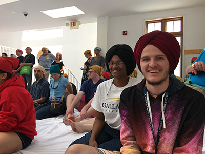 ​Gallaudet students visit the Sikh Gurdwara: Students Starr Portman and Daniel Carson wear some very fine turbans while visiting the Sikh Gurdwara. When you enter, you are required to remove your shoes and cover your hair for cleanliness in the prayer room of a gurdwara.