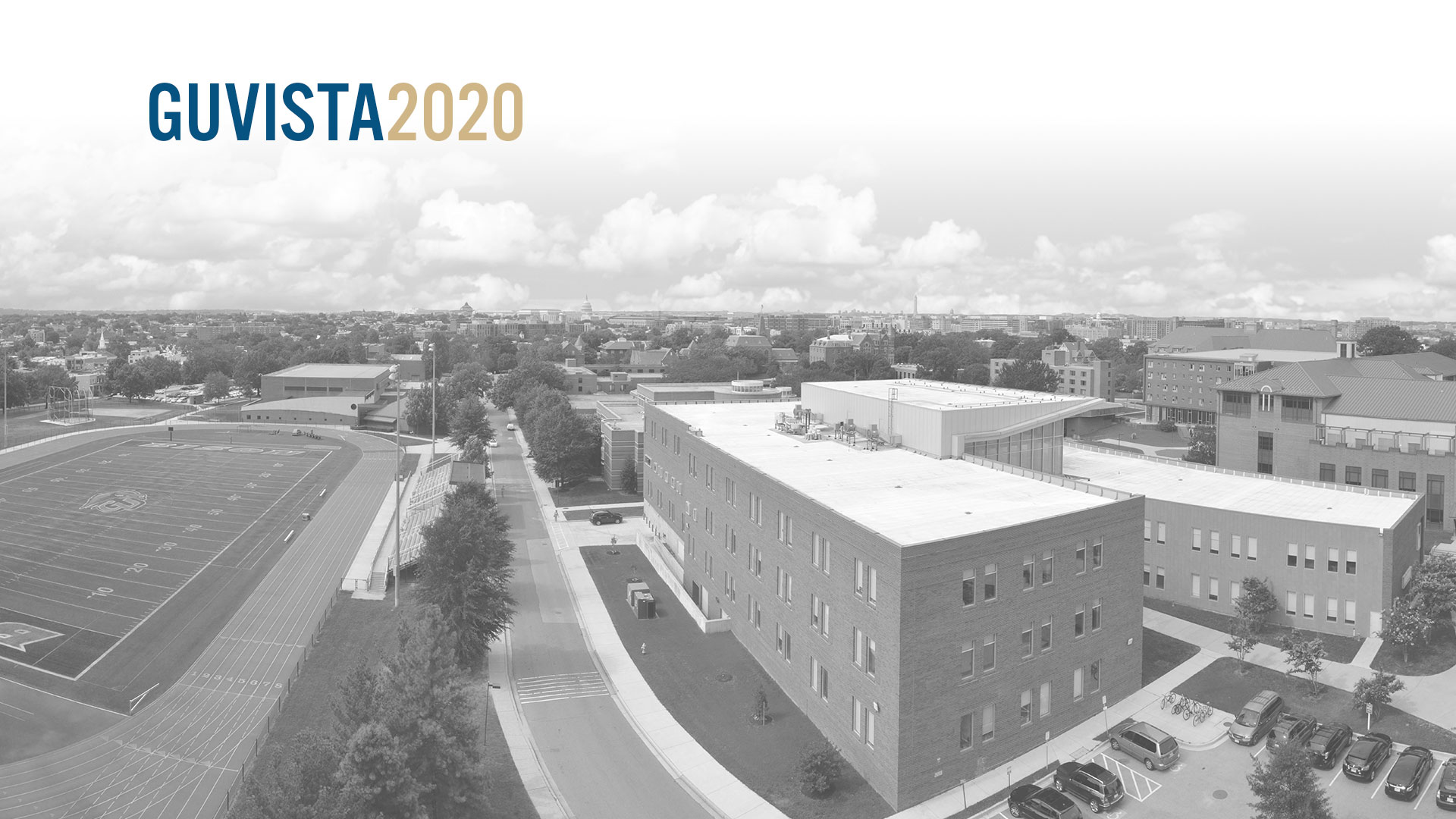 GUVista2020, black and white image of an aerial view of the campus. Football field ot the left and to the right, the Sorenson building.
