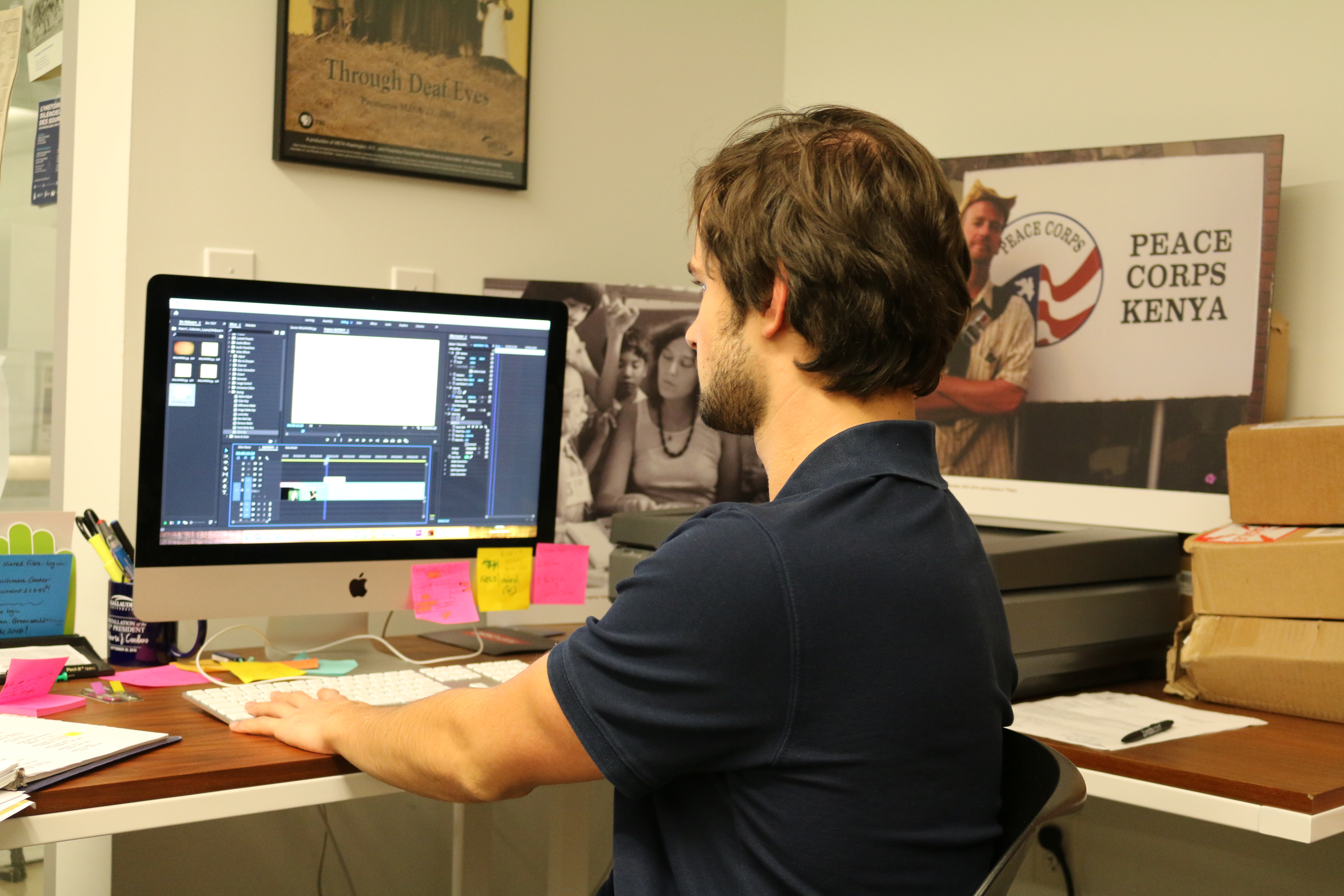 Gideon Firl is editing a video that was shot in the studio. There are two images of Deaf Peace Corps volunteers.