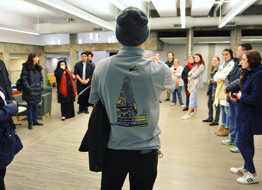 A student ambassador conducting a campus tour for a group of prospects.